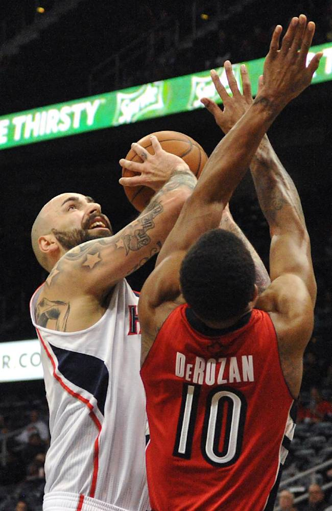 Atlanta Hawks' Pero Antic (6) shoots over Toronto Raptors' DeMar DeRozan (10) in the first half of their NBA basketball game Tuesday, March 18, 2014, in Atlanta