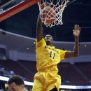 Long Beach State's James Ennis (11) dunks over Cal State Fullerton guard Jared Brandon (1) in the first half of an NCAA college basketball game in the Big West Conference men's tournament Thursday, March 14, 2013, in Anaheim, Calif. (AP Photo/Reed Saxon)