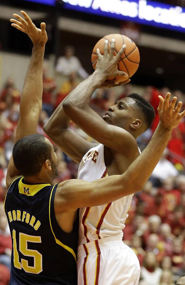 Iowa State forward Melvin Ejim, right, shoots over Michigan forward Jon Horford (15) during the second half of an NCAA college basketball game Sunday, Nov. 17, 2013, in Ames, Iowa. Iowa State won 77-70