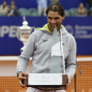 Rafael Nadal, of Spain, bites his trophy after winning the final tennis match at the ATP Argentina Open against Juan Monaco, of Argentina, in Buenos Aires, Argentina, Sunday, March 1, 2015. Nadal won 6-4, 6-1. (AP Photo/Victor R. Caivano)