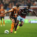 Hull City's Hatem Ben Arfa, left, and West Ham United's Alex Song battle for the ball during the English Premier League soccer match at the KC Stadium, Hull, England, Monday Sept. 15, 2014