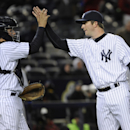 New York Yankees pitcher Adam Warren, right, celebrates with catcher John Ryan Murphy after they defeated the Chicago Cubs 2-0 in Game 2 of an interleague baseball doubleheader on Wednesday, April 16, 2014, at Yankee Stadium in New York The Associated Pre