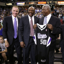 Former Sacramento Kings guard Mitch Richmond, center, laughs at a comment made by NBA Hall of Famer Oscar Robertson as they pose for a photo with Chris Mullin, who is also in the Hall of Fame, during a timeout in a a NBA basketball between the Sacramen