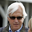 FILE - In this April 27, 2014, file photo, Hall of Fame horse racing trainer Bob Baffert listens to a question during an interview outside Barn 33 at Churchill Downs in Louisville, Ky. Baffert is holding a pretty strong hand heading into Kentucky Derby prep races the next few weeks, with the AP's top-rated Dortmund set for Saturday's San Felipe Stakes, and No. 3 American Pharoah scheduled for the Rebel Stakes on March 14. (AP Photo/Garry Jones, File)