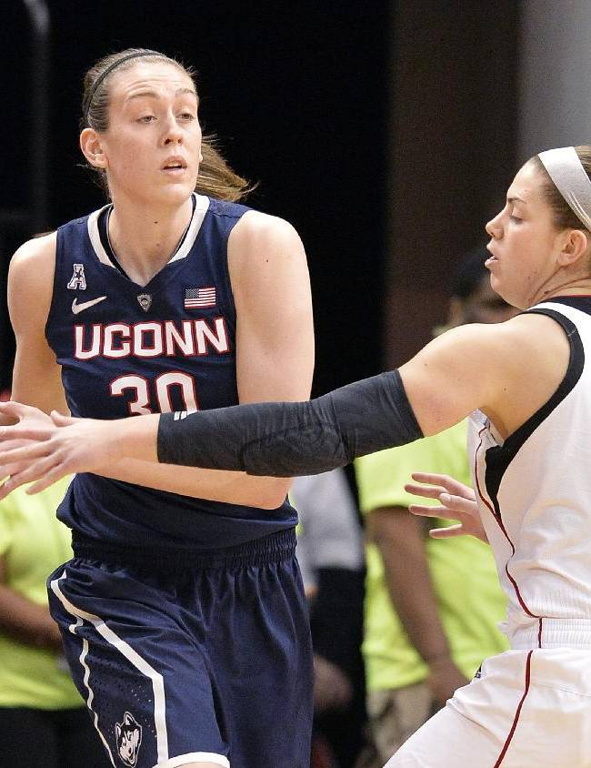 Connecticut's Breanna Stewart, left, looks for help from the defensive pressure of Louisville's Sara Hammond during the first half of an NCAA college basketball game, Monday, March 3, 2014, in Louisville, Ky