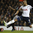 Tottenham's Younes Kaboul, right challenges Burnley's Marvin Sordell during the English FA Cup third round replay soccer match between Tottenham Hotspur and Burnley at the White Hart Lane stadium in London, Wednesday, Jan. 14, 2015