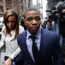 FILE - Ray Rice arrives with his wife Janay Palmer for an appeal hearing of his indefinite suspension from the NFL, in this Wednesday, Nov. 5, 2014 file photo taken in New York. A video released Friday Dec. 19, 2014 shows Ray Rice's then-fiancee crying and kissing him while they are both handcuffed and being taken to jail by police officers after Rice punched her in a casino elevator. (AP Photo/Jason DeCrow, File)
