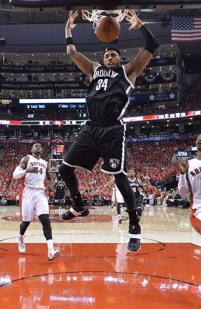 Brooklyn Nets forward Paul Pierce (34) dunks the ball past Toronto Raptors guard Terrence Ross (31) during first half NBA game seven playoff basketball action in Toronto on Sunday, May 4, 2014