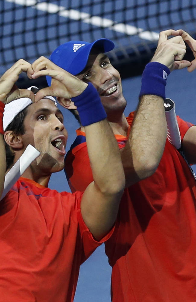 Fernando Verdasco of Spain, left, and David Marrero of Spain celebrate their win against Ivan Dodig of Croatia and Marcelo Melo of Brazil at the end of their ATP World Tour Finals doubles semifinal tennis match at the O2 Arena in London Sunday, Nov. 10, 2013