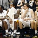 Wichita State players, from left, Nick Wiggins, Carl Hall Jake White and Fred Van Vleet watches their loss to Indiana State during an NCAA college basketball game in Wichita, Kan., Tuesday, Jan. 29, 2013. (AP Photo/The Wichita Eagle, Fernando Salazar)