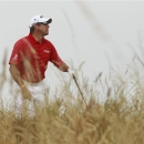Lee Westwood of England looks along the 6th fairway during the final round of the British Open Golf Championship at Muirfield, Scotland, Sunday July 21, 2013. (AP Photo/Peter Morrison)