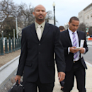 In this April, 2, 2014 file photo, former Northwestern football quarterback Kain Colter, right, and Ramogi Huma, founder and president of the National College Players Association, arrive on Capitol Hill in Washington. Northwestern football players will ca