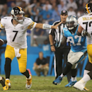 Pittsburgh Steelers quarterback Ben Roethlisberger sticks his arm out as he runs the ball against the Carolina Panthers during an NFL football game Sunday, Sept. 21, 2014, in Charlotte, N.C The Associated Press