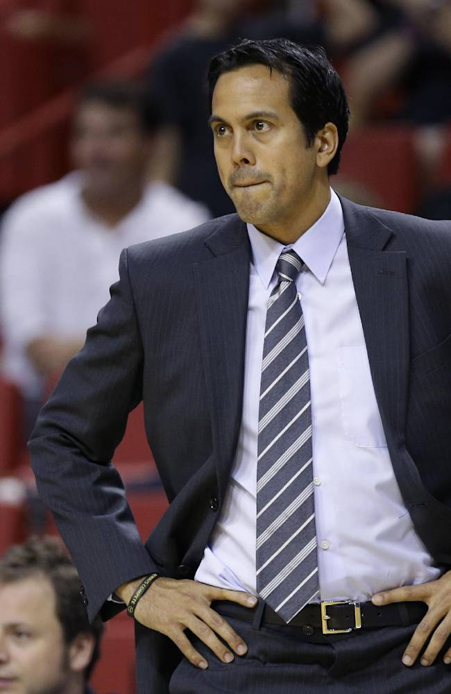 Miami Heat head coach Erik Spoelstra watches during the first half of an NBA preseason basketball game against the San Antonio Spurs, Saturday, Oct. 19, 2013, in Miami