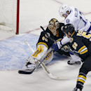 Tampa Bay Lightning center Alex Killorn (17) tries to score against Boston Bruins goalie Tuukka Rask (40) as Bruins defenseman Adam McQuaid (54) closes in during the first period of an NHL hockey game in Boston, Tuesday, Jan. 13, 2015 The Associated Press