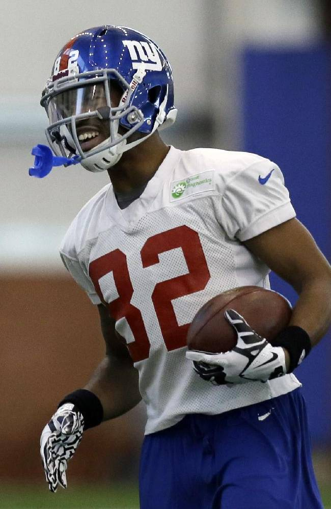 In this Nov. 20, 2013 photo, New York Giants wide receiver Rueben Randle runs with the ball during an NFL football practice in East Rutherford, N.J. The second-year wide receiver has caught six touchdowns in the last six games to take over the team lead. No other receiver has caught a touchdown in that span