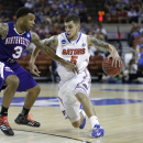 Florida's Scottie Wilbekin (5) drives around Northwestern State's Shamir Davis (3) during the second half of a second-round game of the NCAA college basketball tournament Friday, March 22, 2013, in Austin, Texas. Florida beat Northwestern State 79-47. (AP Photo/Eric Gay)