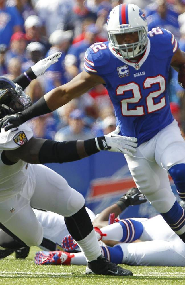 Buffalo Bills running back Fred Jackson (22) runs past Baltimore Ravens outside linebacker Courtney Upshaw (91) during the first half of an NFL football game on Sunday, Sept. 29, 2013, in Orchard Park, N.Y