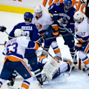 Vancouver Canucks' Ryan Kesler, far left, scores against New York Islanders' goalie Evgeni Nabokov, centre, of Russia, as Casey Cizikas (53), Thomas Hickey (14) and Brian Strait defend against Canucks' Kevin Bieksa and Alex Burrows, right, during second p