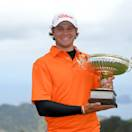 FUNCHAL, MADEIRA, PORTUGAL - MAY 19:  Peter Uihlein of  USA poses with the trophy after winning the Madeira Islands Open - Portugal - BPI at Club de Golf do Santo da Serra on May 19, 2013 in Funchal, Madeira, Portugal.  (Photo by Mark Runnacles/Getty Images)