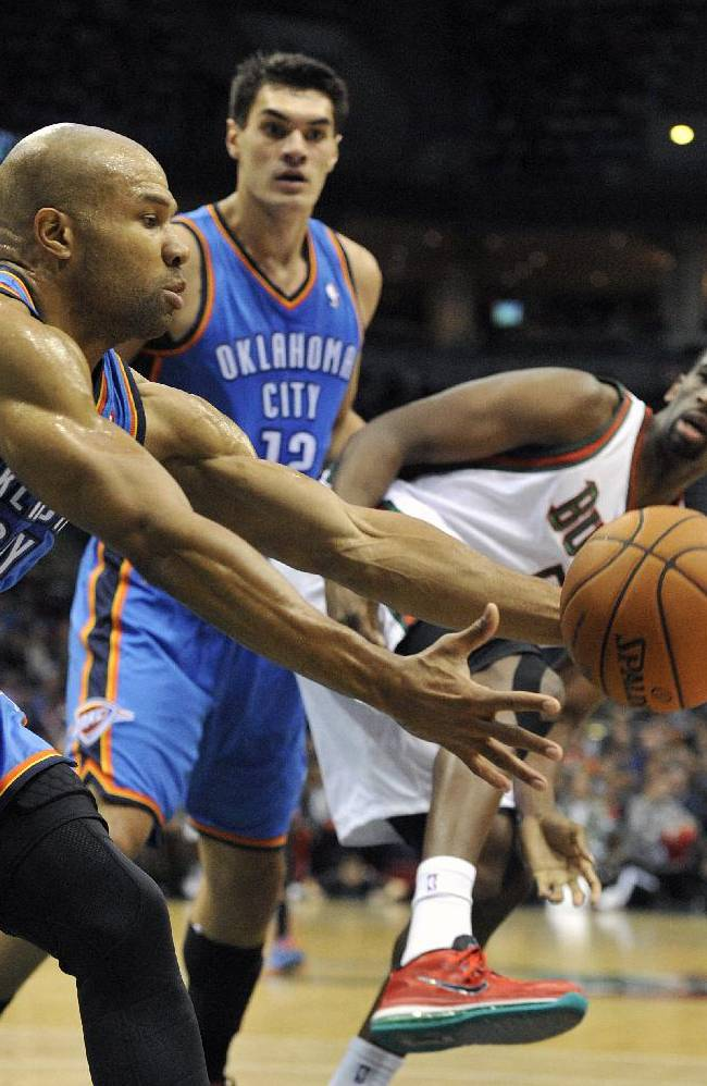 Oklahoma City Thunder's Derek Fisher (6) grabs a rebound as teammate Steven Adams and Milwaukee Bucks' Ekpe Udoh fight for position during the first half of an NBA basketball game Saturday, Nov. 16, 2013, in Milwaukee
