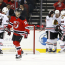 Chicago Blackhawks left wing Bryan Bickell, second from right, is congratulated by Michal Rozsival, right, of the Czech Republic, and Patrick Sharp, third from left, after scoring a goal against the New Jersey Devils during the second period of an NHL hoc