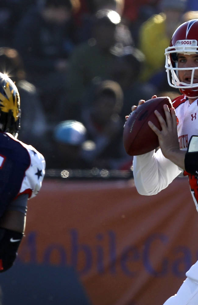 South quarterback Derek Carr (4), of Fresno St., rolls out to pass away from the pressure of North line backer Michael Sam (55), of Missouri, during the first half of the Senior Bowl NCAA college football game on Saturday, Jan. 25, 2014, in Mobile, Ala