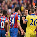 Chelsea's John Terry confronts the referee as a red card is shown for Chelsea's Cesar Azpilicueta for a foul on Crystal Palace's Mile Jedinak during their English Premier League soccer match at Selhurst Park, London, Saturday, Oct. 18, 2014