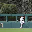 Philadelphia Phillies center fielder Ben Revere (2) loses control of the ball at the wall on a ball hit by Milwaukee Brewers' Mark Reynolds during the seventh inning of a baseball game Tuesday, April 8, 2014, in Philadelphia. Revere was charged with an er