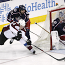 Columbus Blue Jackets' Fedor Tyutin (51) pushes Colorado Avalanche's Jamie McGinn (11) from behind as he tries to score on goalie Sergei Bobrovsky during the third period of an NHL hockey game, Tuesday, April 1, 2014, in Columbus, Ohio The Associated Pres