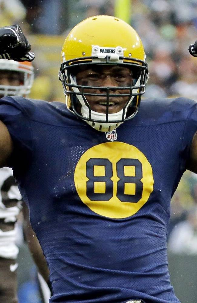 In this Oct. 20, 2013, file photo, Green Bay Packers' Jermichael Finley reacts after catching a pass during the first half of an NFL football game against the Cleveland Browns, in Green Bay, Wis. Finley has tweeted that he left the intensive care unit and had full feeling in his arms and legs after injuring his neck in a game. Finley posted Monday night, Oct. 21, 2013, on Twitter that he was able to walk to and from the shower. He thanked family, friends, teammates and fans for an outpouring of support