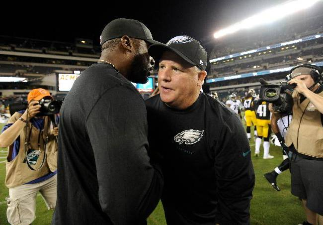 Philadelphia Eagles head coach Chip Kelly, front right, and Pittsburgh Steelers head coach Mike Tomlin meet after an NFL preseason football game, Thursday, Aug. 21, 2014, in Philadelphia. Philadelphia won 31-21