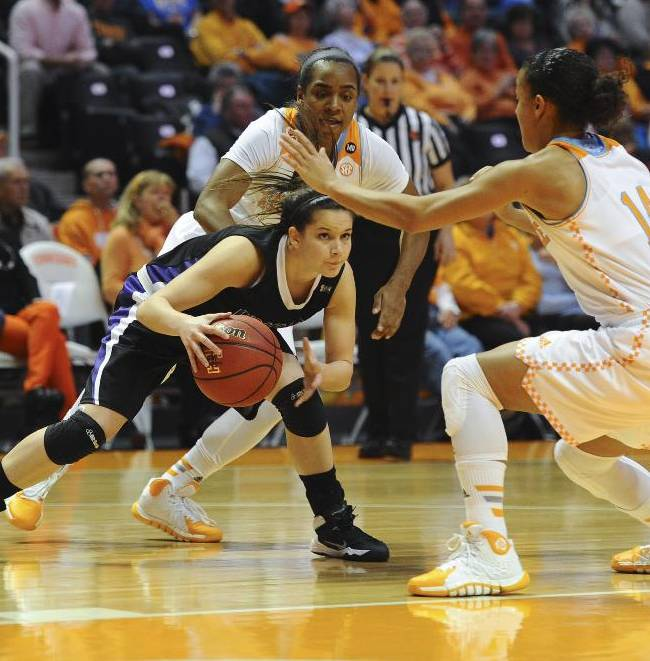 Lipsomb's Maya Dillard looks for an open teammate against Tennessee's Andraya Carter (14) in the first half of an NCAA college basketball game Sunday, Dec. 29, 2013, in Knoxville, Tenn