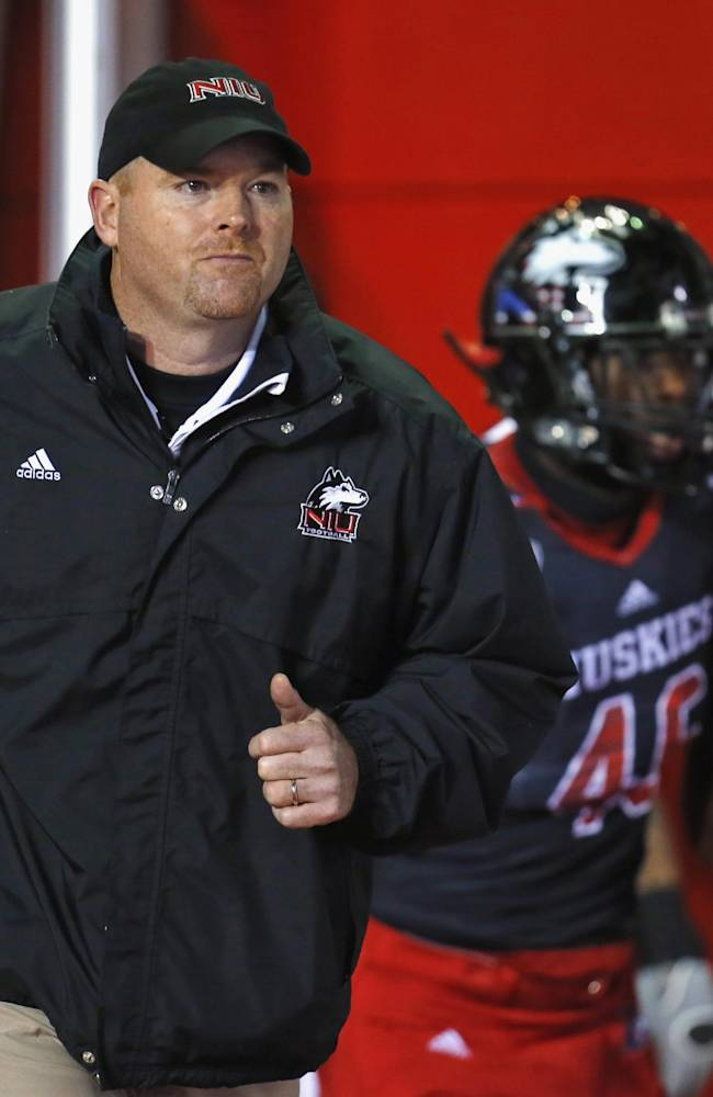 In this Nov. 13, 2013 file photo, Northern Illinois head coach Rod Carey leads his team onto the field before an NCAA college football game against Ball State in DeKalb, Ill. Carey has a shot at the conference championship and a chance to crash the BCS party again as he winds up his first full season as NIU's head coach. With Heisman Trophy candidate Jordan Lynch at quarterback, the 16th-ranked Huskies will try to remain unbeaten and capture their third straight Mid-American Conference championship when they meet Bowling Green in the title game in Detroit on Friday, Dec. 6