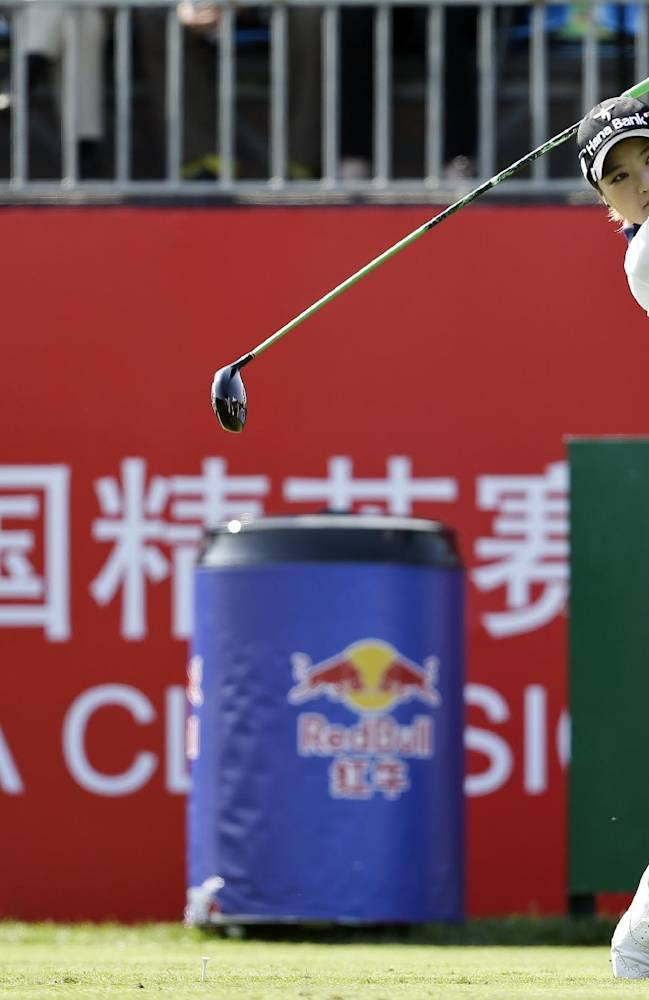South Korea's So Yeon Ryu follows her ball after teeing off on the first hole during the first round of the Reignwood LPGA Classic golf tournament at Pine Valley Golf Club on the outskirts of Beijing, China, Thursday, Oct. 3, 2013