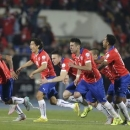 Chile players celebrate after defeating Argentina in their Copa America 2015 final soccer match at the National Stadium in Santiago, Chile, July 4, 2015. REUTERS/Jorge Adorno