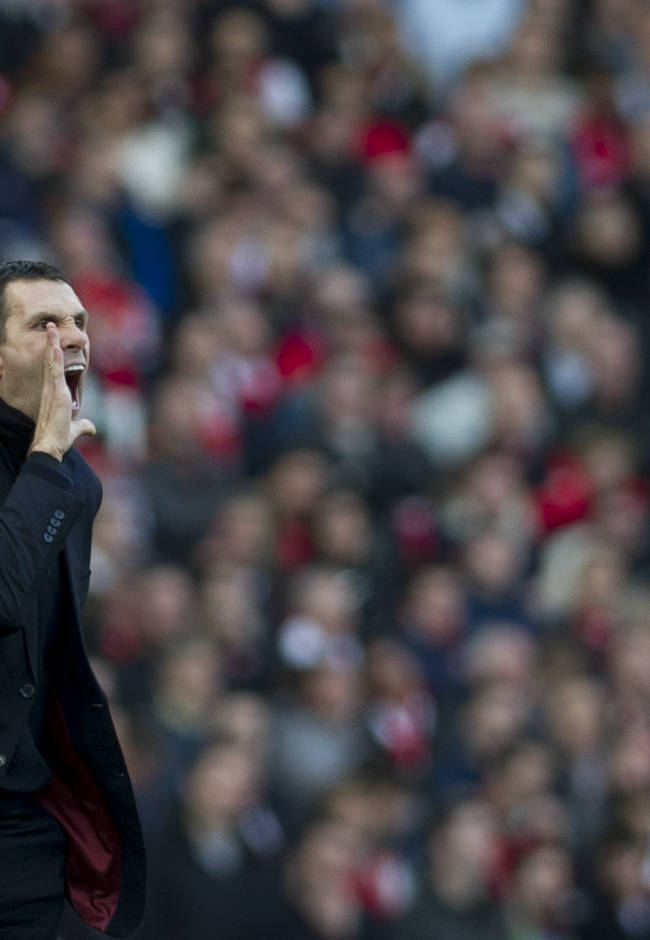 Sunderland's manager Gus Poyet, reacts during their English Premier League soccer match against Arsenal, at Emirates Stadium, in London, Saturday, Feb. 22, 2014