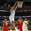 North Carolina forward Brice Johnson (11) dunks as forward Kennedy Meeks (3) and Ohio State forward Sam Thompson (12), guard Shannon Scott (3) look on during the first half of an NCAA college basketball game in CBS Sports Classic on Saturday, Dec. 20, 2014, in Chicago. (AP Photo/Charles Rex Arbogast)