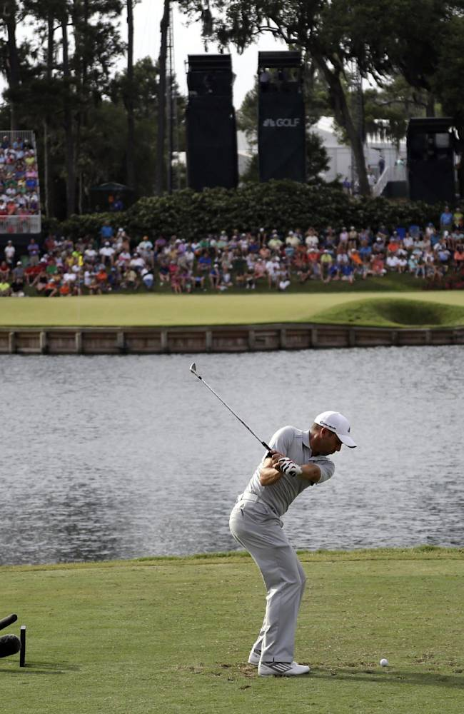 Spieth goes bogey-free and ties Kaymer at Players