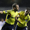 Sunderland's Lee Cattermole, left, celebrates scoring a goal with Fabio Borini during the English Premier League soccer match between Tottenham Hotspur and Sunderland at White Hart Lane stadium in London, Monday, April 7, 2014