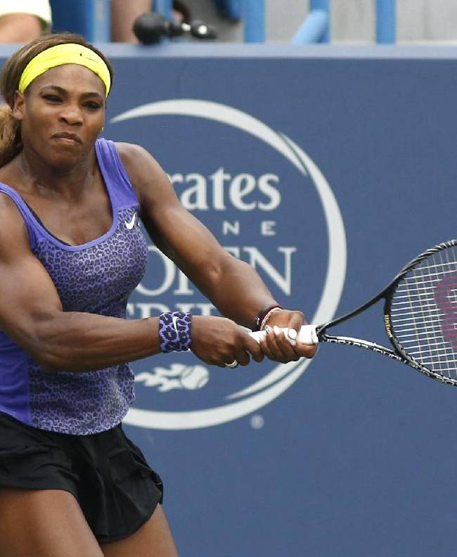 Serena Williams returns to Caroline Wozniacki, from Denmark, during a semifinal match at the Western & Southern Open tennis tournament, Saturday, Aug. 16, 2014, in Mason, Ohio