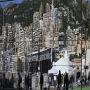 A view of Monaco is reflected in a mirror of a motorhome in the paddock prior to the start of the first free practice at the Monaco racetrack, in Monaco, Thursday, May 23, 2013. The Formula one race will be held on Sunday. (AP Photo/Luca Bruno)