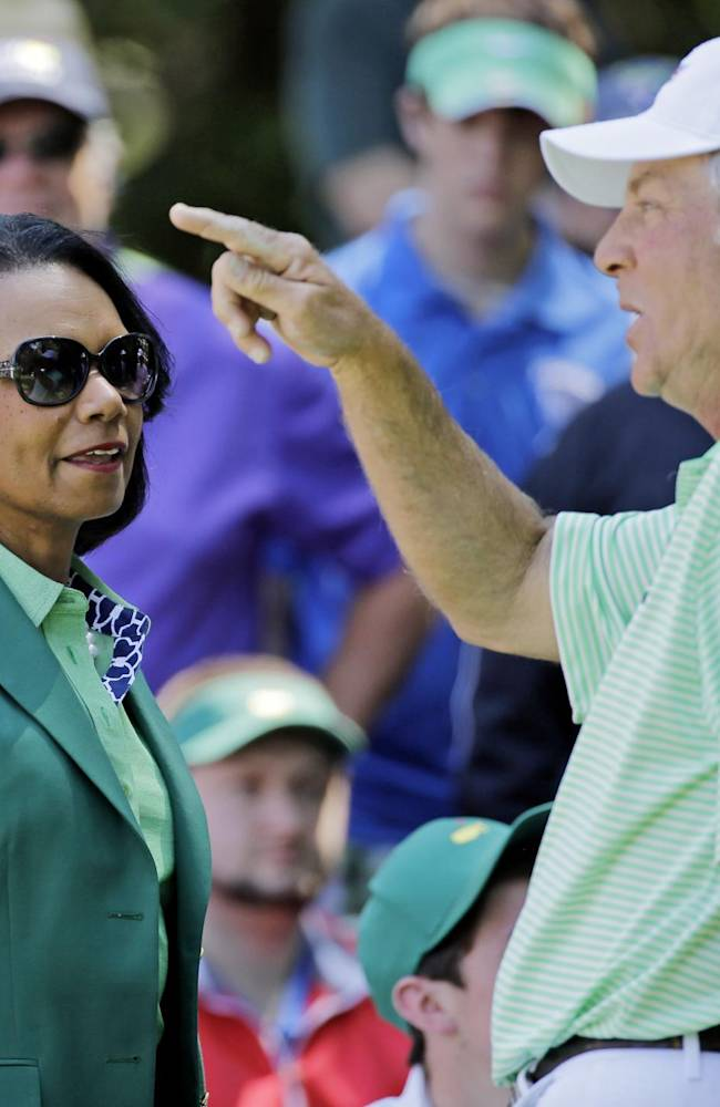 Former U.S. Secretary of State Condoleezza Rice speaks with Ben Crenshaw during the par three competition at the Masters golf tournament Wednesday, April 9, 2014, in Augusta, Ga