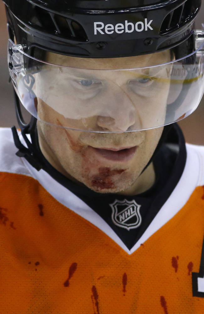 Philadelphia Flyers' Kimmo Timonen, of Finland, skates on the ice during a break after being injured in the second period of an NHL hockey game against the Boston Bruins, Sunday, March 30, 2014, in Philadelphia