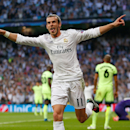 Real Madrid's Gareth Bale celebrates after scoring the opening goal during the Champions League semifinal second leg soccer match between Real Madrid and Manchester City at the Santiago Bernabeu stadium in Madrid, Wednesday May 4, 2016. (AP Photo/Fran