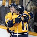 Nashville Predators forward Colin Wilson, left, celebrates with Mike Fisher (12) after Wilson scored against the Philadelphia Flyers in the third period of an NHL hockey game Saturday, Nov. 30, 2013, in Nashville, Tenn The Associated Press