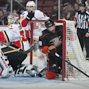 The Ducks' Patrick Maroon ends up in the net behind Calgary goaltender Joni Ortio during the first period of hockey at Honda Center Wednesday night Jan. 21, 2015 The Associated Press
