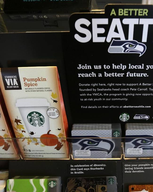 Special Seattle Seahawks Starbucks cards are displayed on Wednesday, Oct. 23, 2013, at a Starbucks store in Seattle. The Seahawks began a one-week fund-raising campaign Wednesday with Starbucks to benefit Seahawks head coach Pete Carroll's A Better Seattle program, which seeks to reach at-risk youth and prevent gang violence