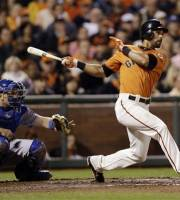 San Francisco Giants' Angel Pagan drives in a run with a single against the Los Angeles Dodgers during the third inning of a baseball game Friday, Sept. 7, 2012, in San Francisco. (AP Photo/Marcio Jose Sanchez)