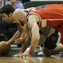 Milwaukee Bucks' ZaZa Pachulia, left, and Washington Wizards' Marcin Gortat go to the floor for a loose ball during the second half of an NBA basketball game on Saturday, March 8, 2014, in Milwaukee The Associated Press